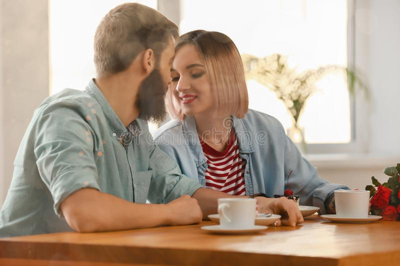 Loving young couple during romantic date in cafe stock photos