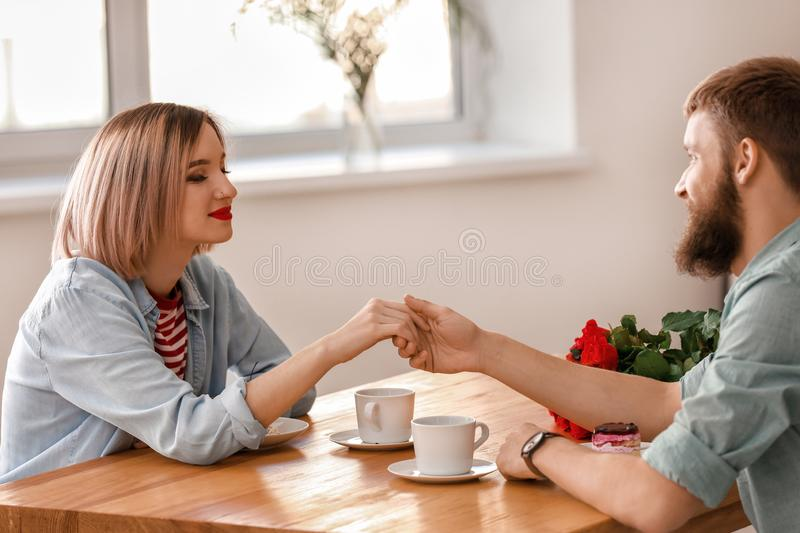 Loving young couple during romantic date in cafe royalty free stock image