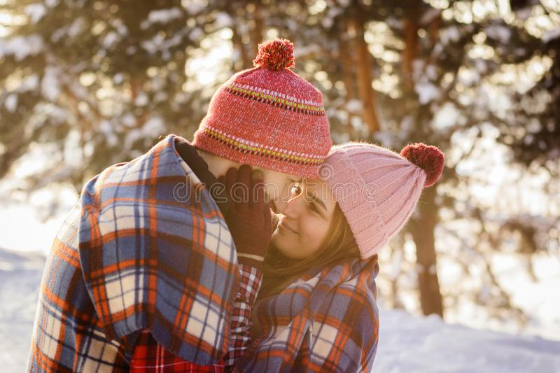 Loving young couple in winter under a ruffled embrace. Close up royalty free stock photos