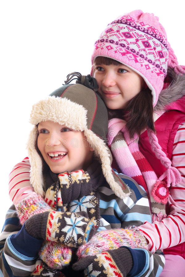 Loving young siblings. Sister and brother dressed in winter clothing royalty free stock image