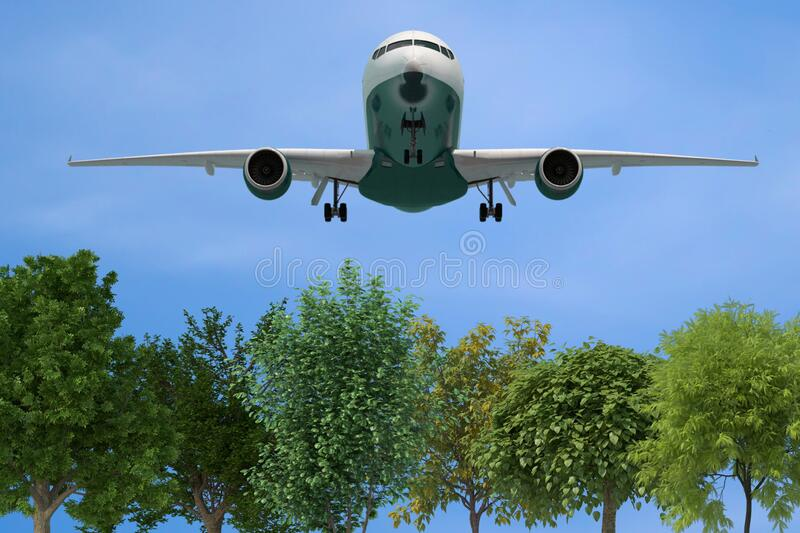 Low airplane over trees. Low level isolated airplane / jet taking off or landing over green trees stock photo