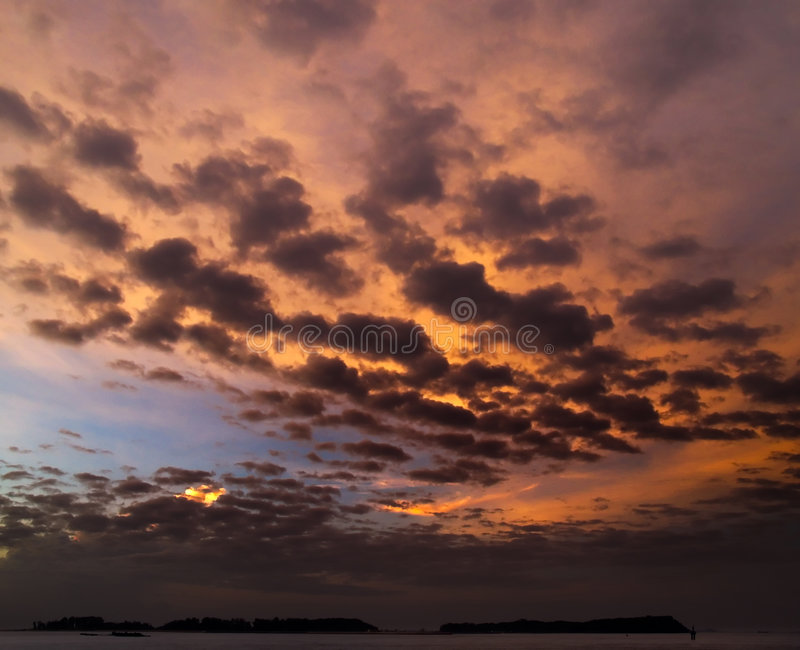 Low Altitude Clouds. Wave of rolling low altitude clouds revealed at dawn by the rising sun stock image