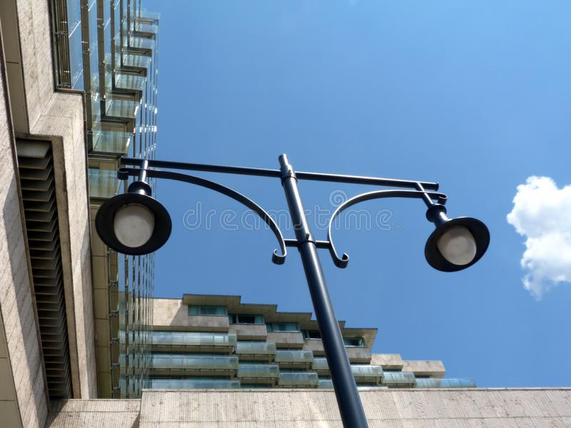 glass balconies on modern hotel building with retro style street lamp below stock photos