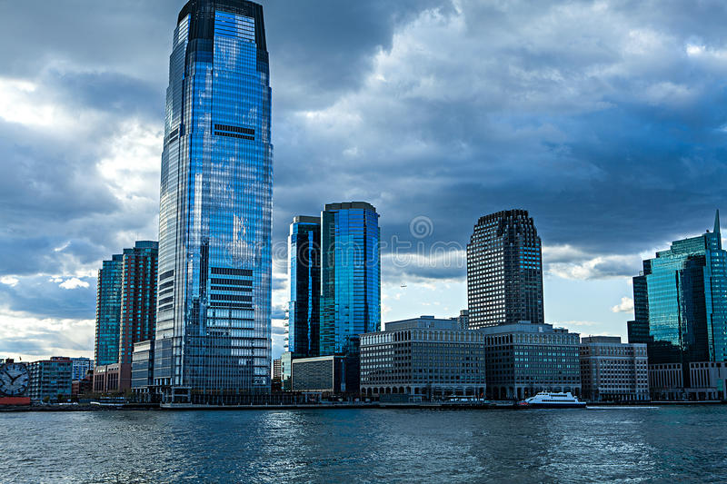 Low Angle Architectural View of Modern Glass Skyscrapers Featuring One World Trade Center Building Against Blue Sky. Manhattan, New York City, New York, USA stock photography