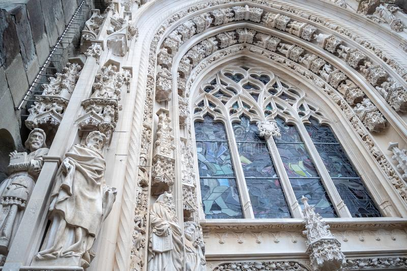 Low angle of beautiful sculpture and mosaic  window at the entrance of Laussane Cathedral stock image