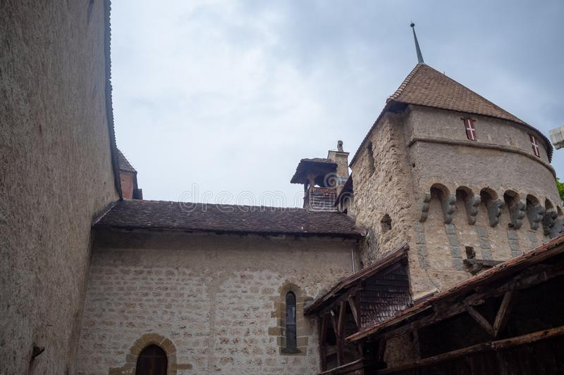 Low angle of beautiful tower in chateau de chillon, castle in Montreux Switzerland, on cloudy sky background stock photos
