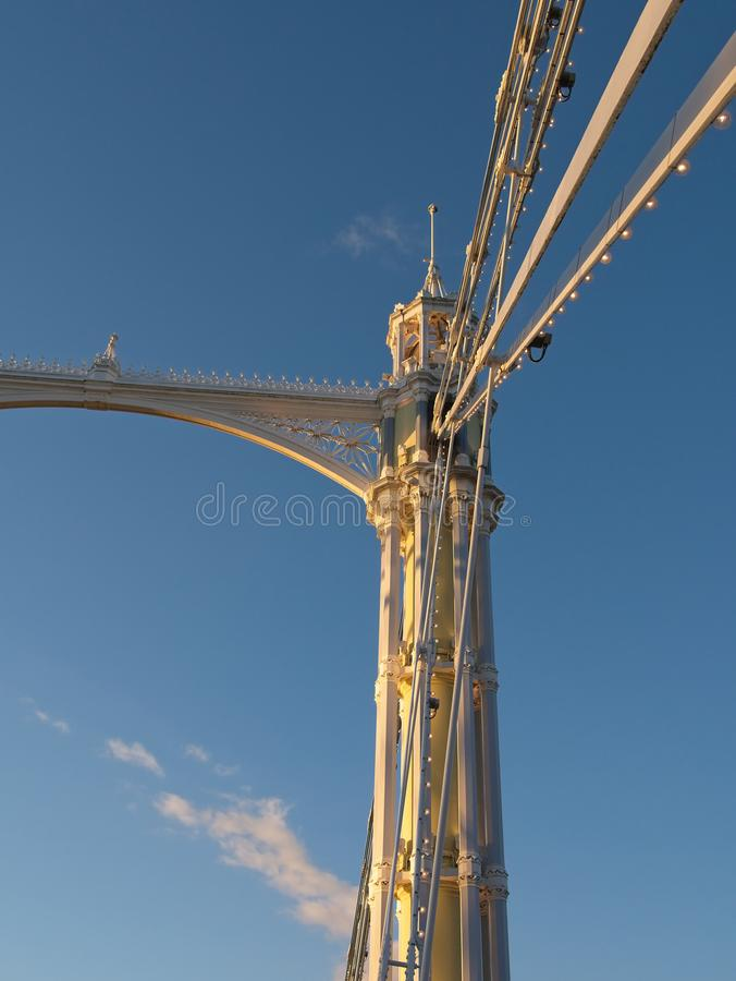 Low angle and close-up view of steel pillars of a suspension bridge against blue sky. royalty free stock photo
