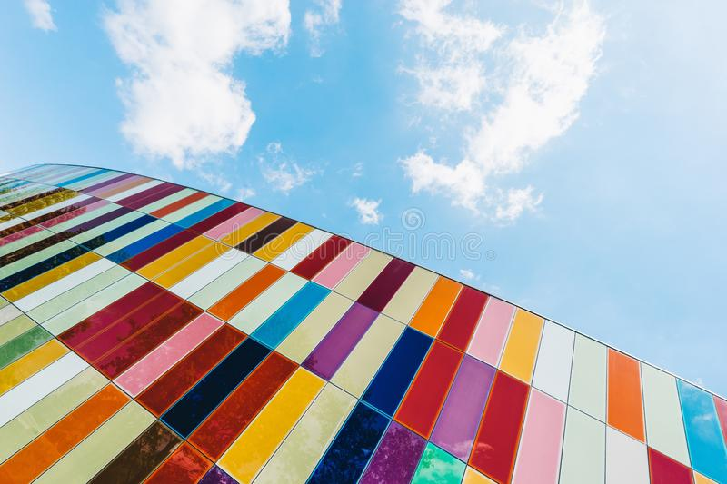 Low Angle of Colorful Glass Panels Under Blue Sky stock images