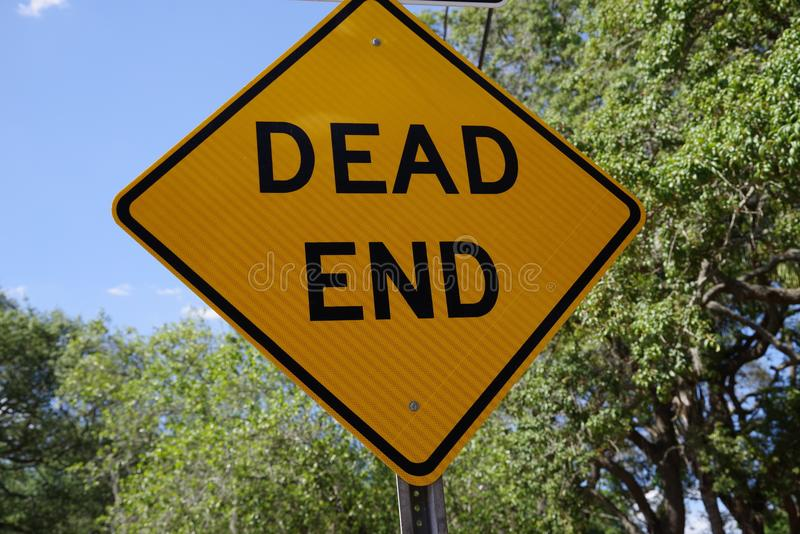 Low angle of a dead end street sign with a closeup view of dead end stock images
