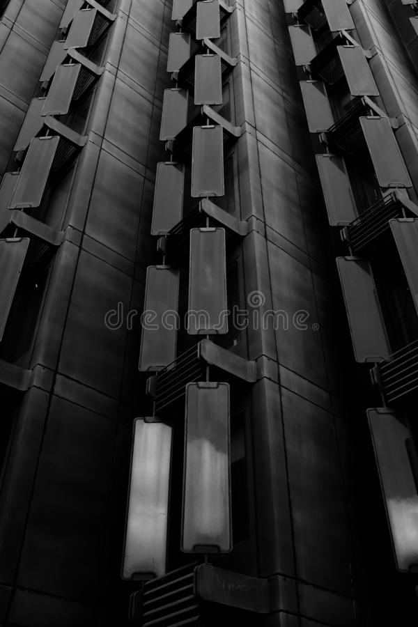 Low angle greyscale shot of a tall modern building stock illustration