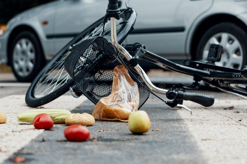 Low angle on groceries and bike after car accident with drunk dr stock images