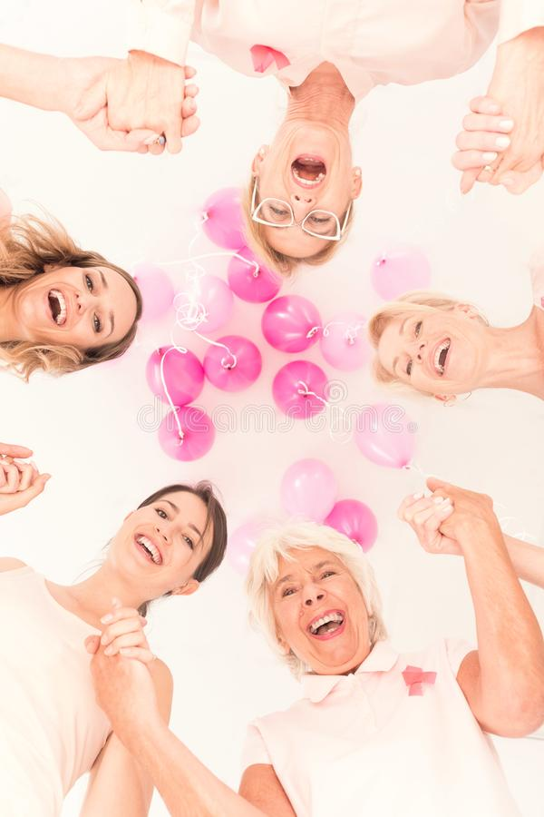 Fighting together against breast cancer royalty free stock image