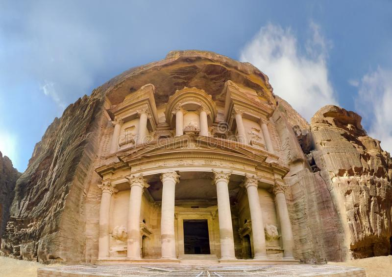 Low angle panoramic view of the facade of the Treasury building in the ancient Nabatean ruins royalty free stock photos