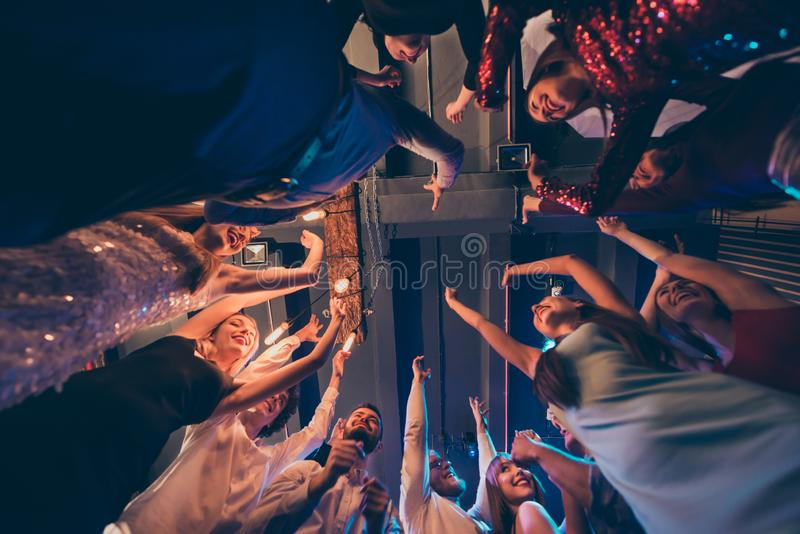 Low angle photo of cheerful positive crowd people students celebrate festive events stand round circle dance have fun royalty free stock images