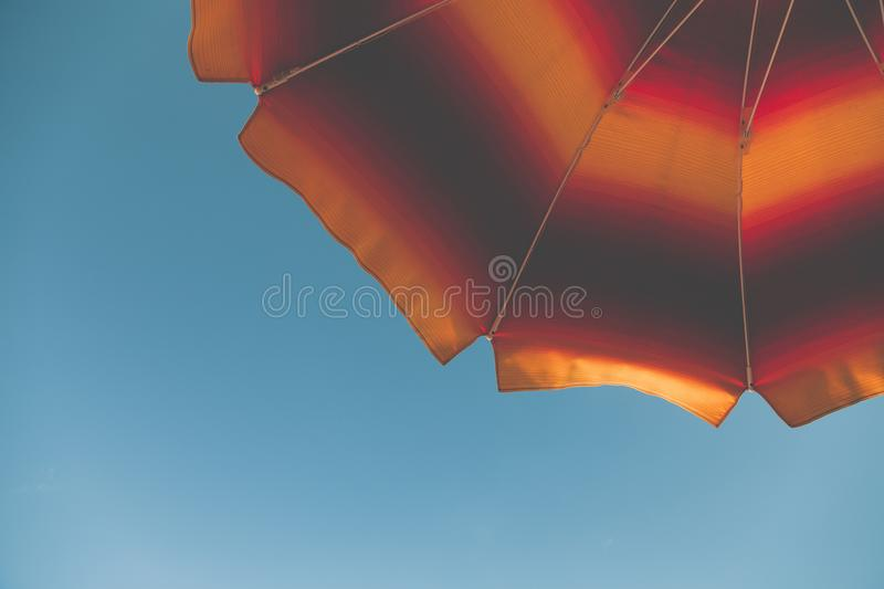 Low Angle Photography of Black and Orange Beach Umbrella royalty free stock photography