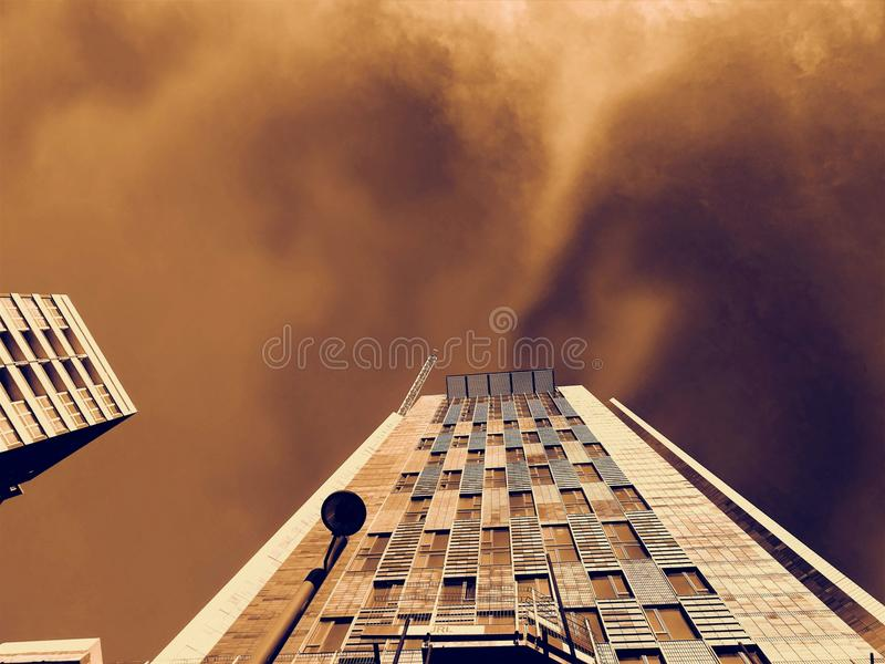 Low-angle Photography of Brown Concrete Building Under Brown Clouds royalty free stock photography