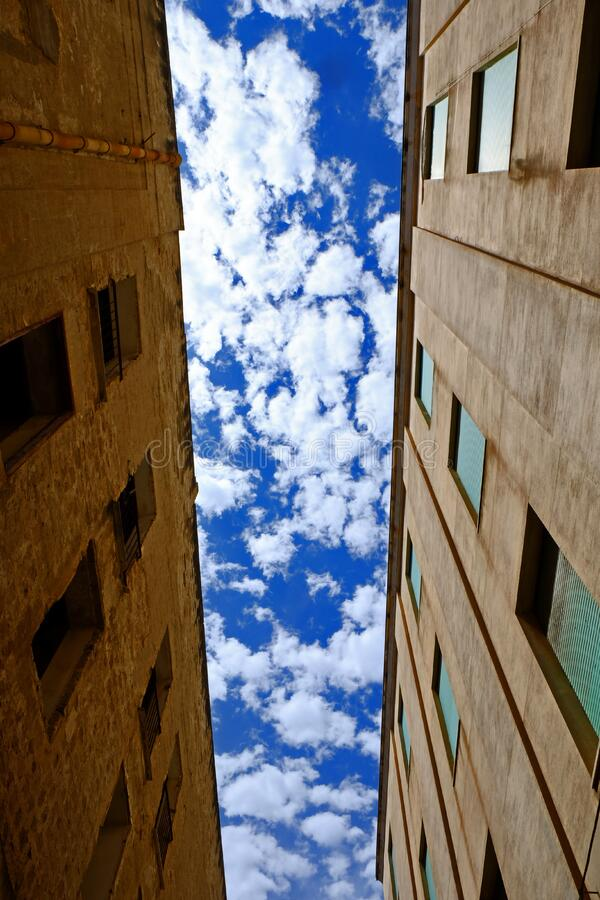 Low Angle Photography of Brown Concrete Building Under White Cloudy Blue Sky at Daytime royalty free stock photos