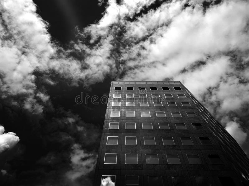 Low-angle Photography of Concrete High-rise Building Under Cloudy Skies royalty free stock photo