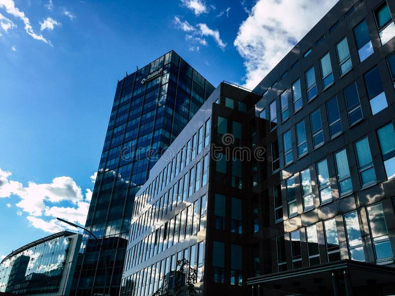 Low-angle Photography of Curtain Wall Building Taken Under White Clouds and Blue Sky stock photos