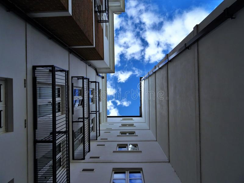Low-angle Photography of Gray Concrete Building Under Blue Sky at Daytime stock photo