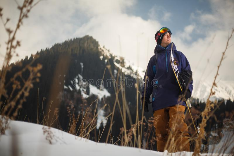 Low Angle Photography of Man Wearing Blue Jacket Carrying Snow Board stock images