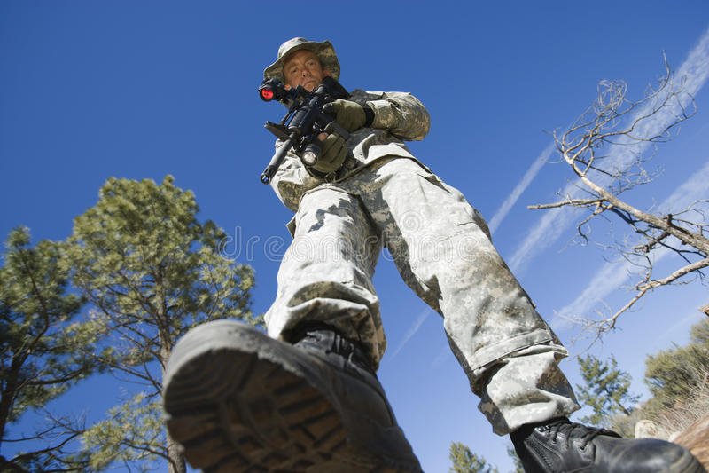 Low Angle Portrait Of Armed Soldier stock images