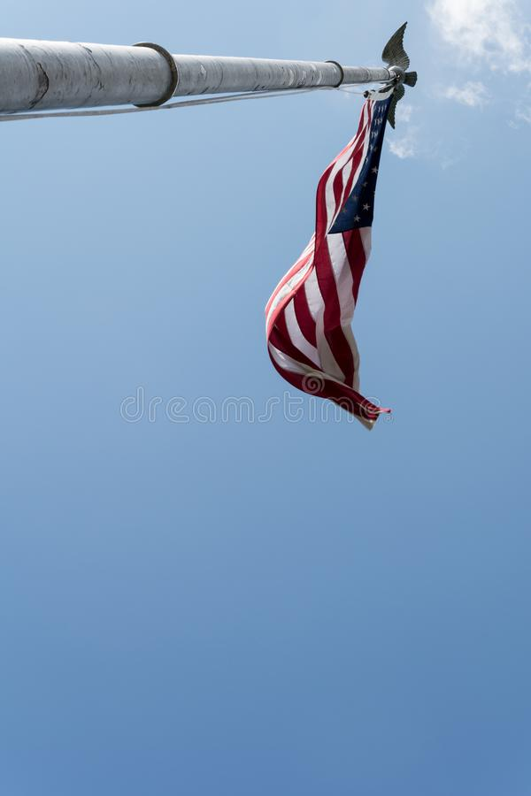 Low angle shot of American Flag on vintage flagpole royalty free stock image