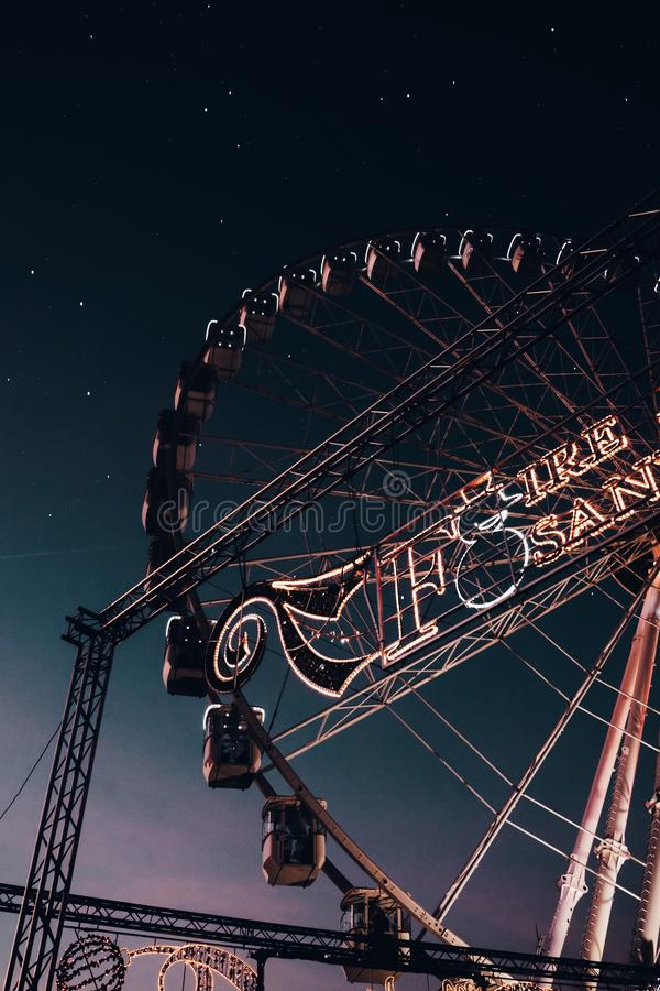 Low angle shot of a beautiful Ferris wheel in a park at night with amazing stars in the background stock photos