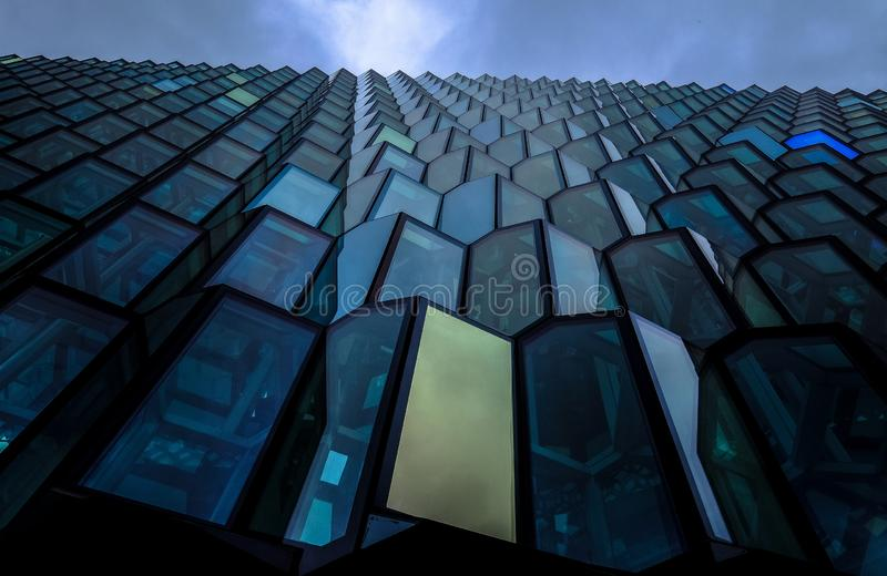 Low angle shot of a blue high rise brutalist architectural building stock photos