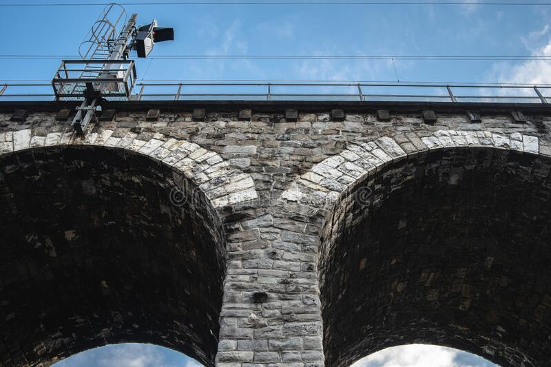 Low angle shot of the brick arches of a viaduct in Zurich Switzerland against a blue sky. A low angle shot of the brick arches of a viaduct in Zurich Switzerland stock photos