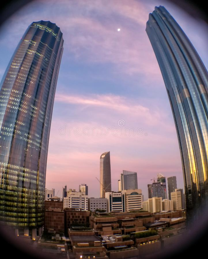 Low angle shot with a fish eye lens of the WTC Tower on a cloudy sunset in Abu Dhabi royalty free stock images