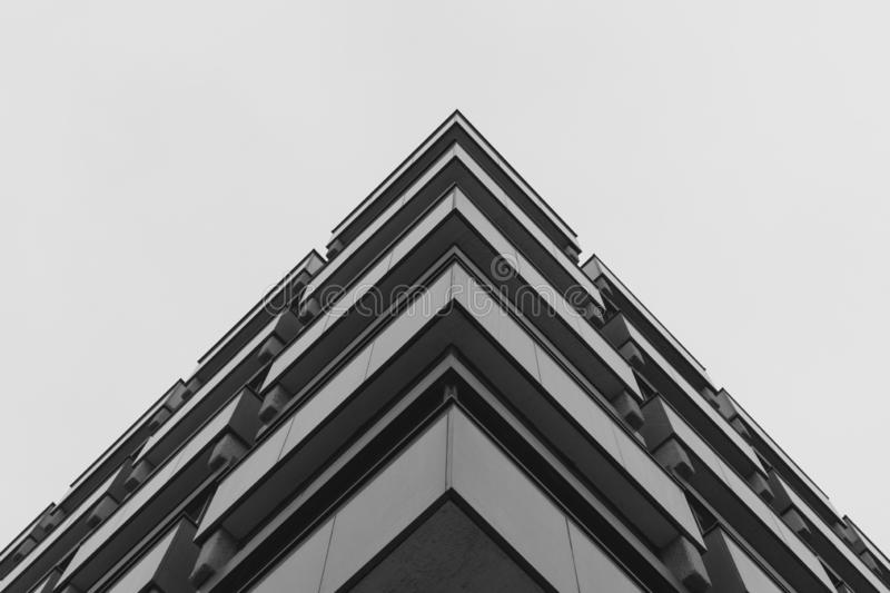 Low angle shot of a grey concrete building representing modern architecture royalty free stock photos