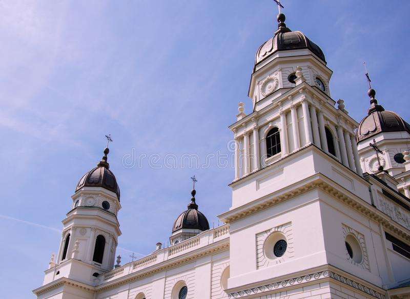 Low angle shot of metropolitan cathedral in Iasi Romania with a background of beautiful blue sky. A low angle shot of metropolitan cathedral in Iasi Romania with royalty free stock photo
