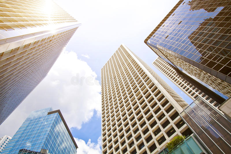 Low angle shot of modern glass city buildings royalty free stock photography