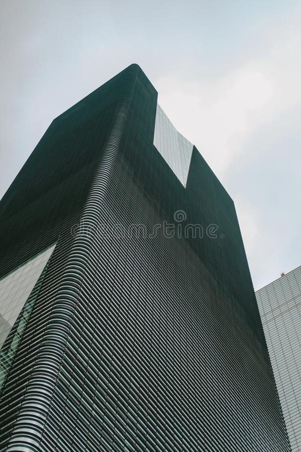 Low angle shot of a tall high-rise modern business building with a clear sky in the background royalty free stock image