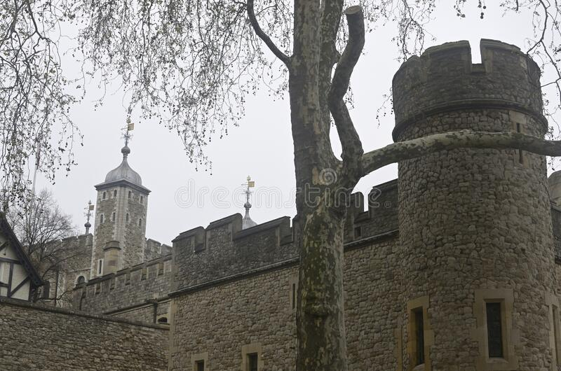 Low angle shot of a Tower of London, United Kingdom with a gray sky in the background. A low angle shot of a Tower of London, United Kingdom with a gray sky in royalty free stock image