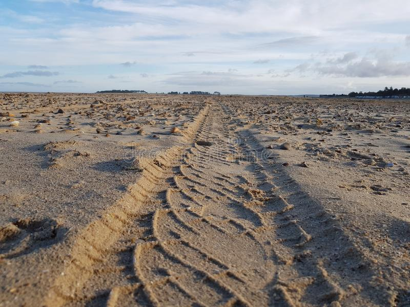 Tracks in sand stock image