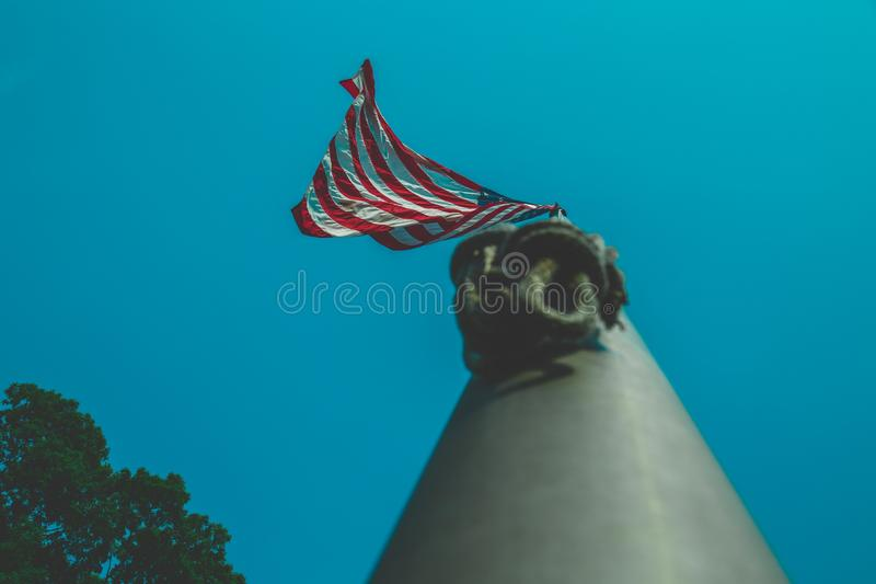Low angle shot of US or American flag on a flagpole. A low angle shot of US or American flag on a flagpole stock photography