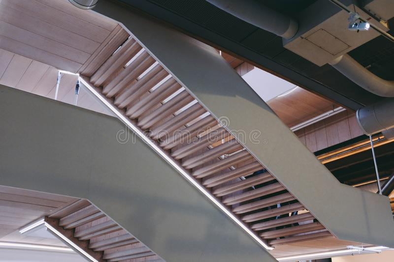 Low angle shot of the wooden stairway in a modern building royalty free stock photos
