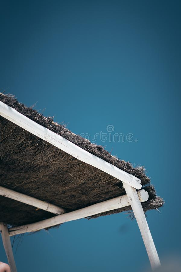 Low angle vertical shot of the roof of a gazebo under a clear blue beautiful sky. A low angle vertical shot of the roof of a gazebo under a clear blue beautiful stock images