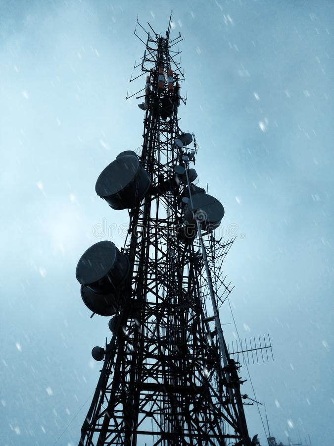 Low angle vertical shot of a satellite tower with a clear sky in the background. A low angle vertical shot of a satellite tower with a clear sky in the stock photos