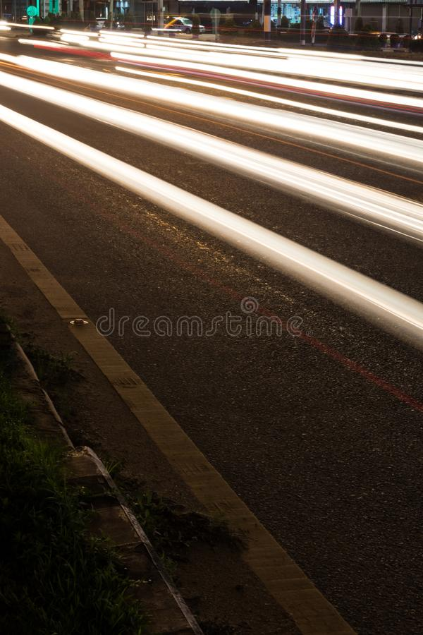 Low angle view of car lights at night. stock images
