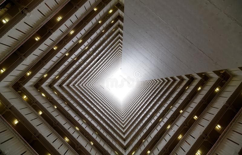 Low angle view from the atrium of a high-rise residential tower of a public housing. Estate in Hong Kong ~ Overcrowded narrow apartments in a tower block, a royalty free stock images