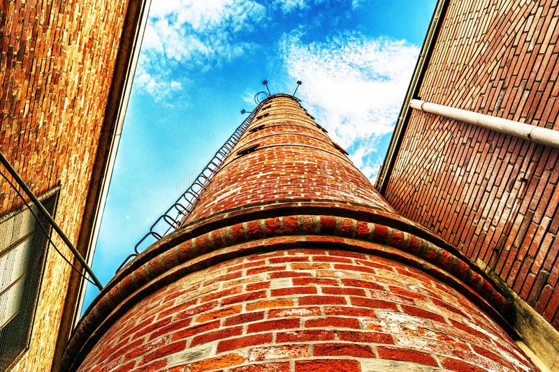Low Angle View of Brown Bricks Tower royalty free stock images