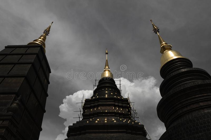 Low angle view of buddhist pagoda rising up into dramatic cloudy sky stock images