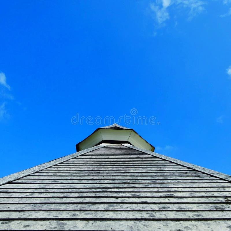 Low angle view of building against cloudy sky. Low angle view of building against cloudy royalty free stock photos
