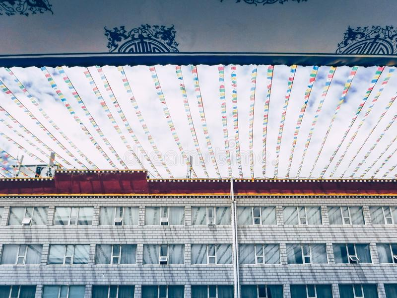 Low angle view of building in Lhasa, Tibet. Low angle view of building with colourful flags in Lhasa, Tibet stock photo