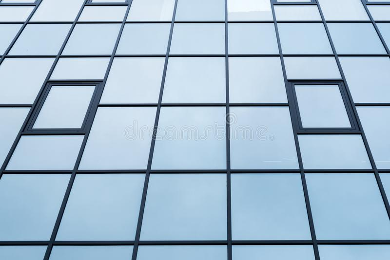 Low angle view of building. Windows texture royalty free stock photos