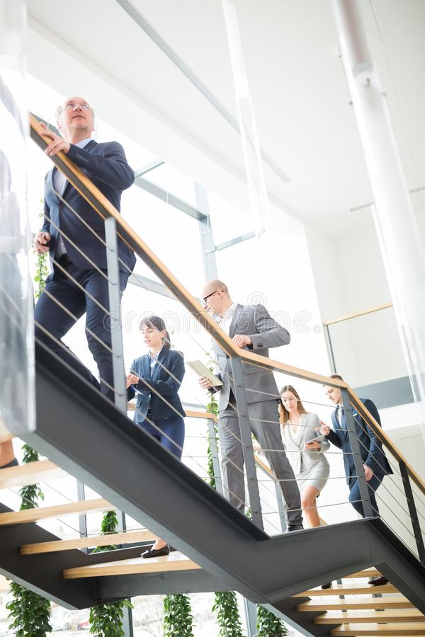 Business Colleagues Climbing Stairs In Modern Office royalty free stock photo