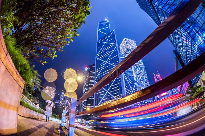 Low angle view of cityscape blue building at Night in the rain Hong Kong. China royalty free stock images